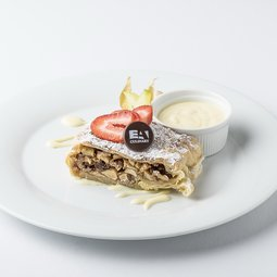 Granny's apple strudel with nuts and vanilla sauce