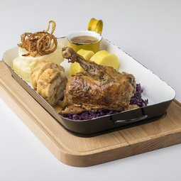 Roasted duck with rosemary and apples, served with red cabbage and an assortment of Czech dumplings